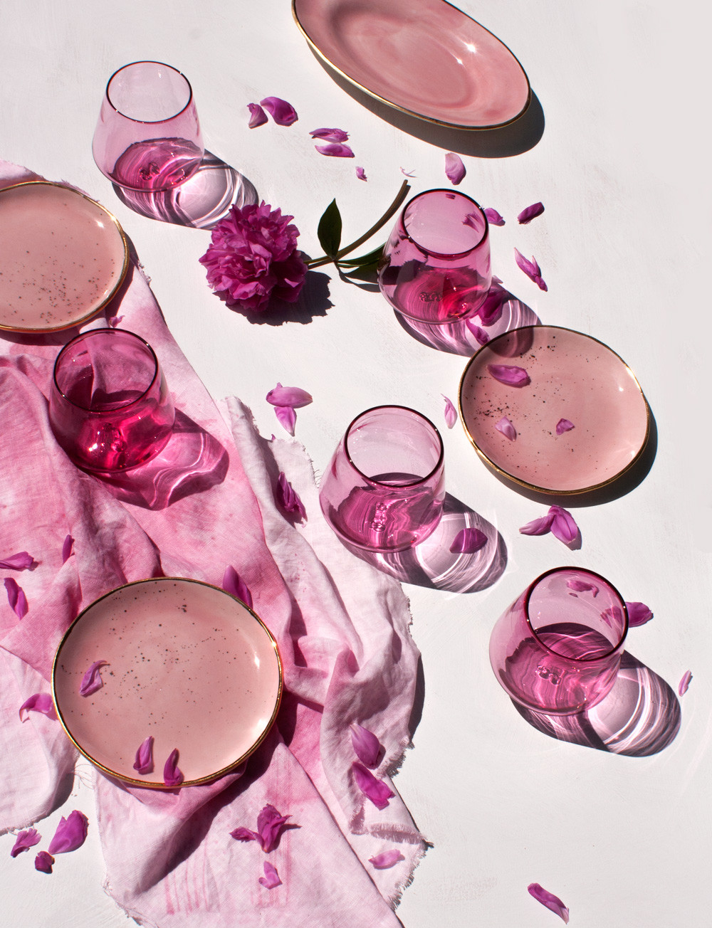 suite-one-studio-peony-pink-glassware-with-peony-petals-and-oval-platter-in-rose-with-gold-and-dessert-plates-in-rose-with-gold-splatter-vertical.jpg