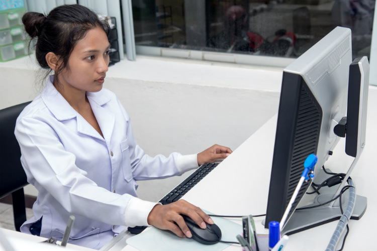 woman doctor working on computer employee  works with a computer  in hospital researcher working