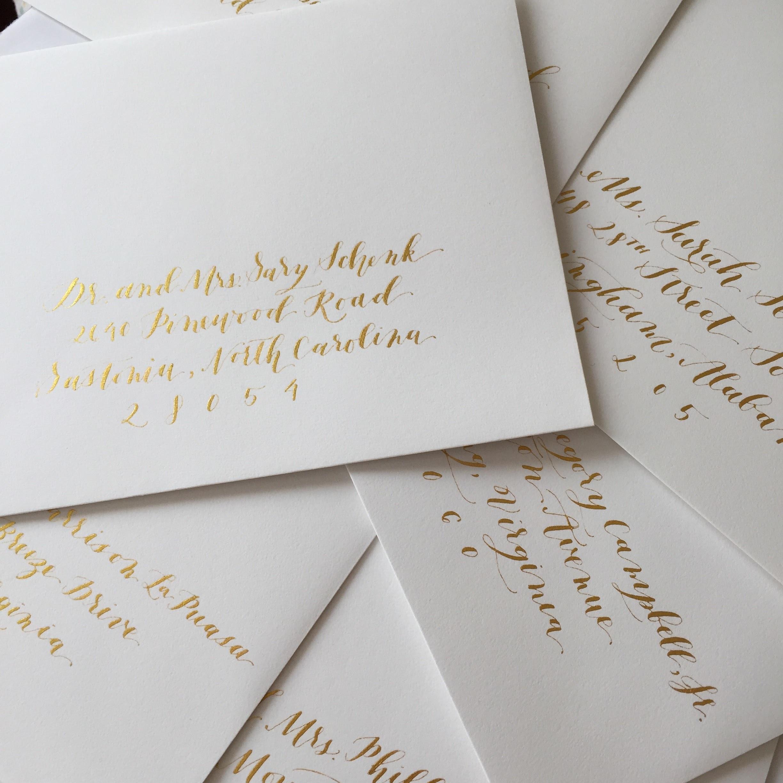 gold calligraphy wedding envelopes