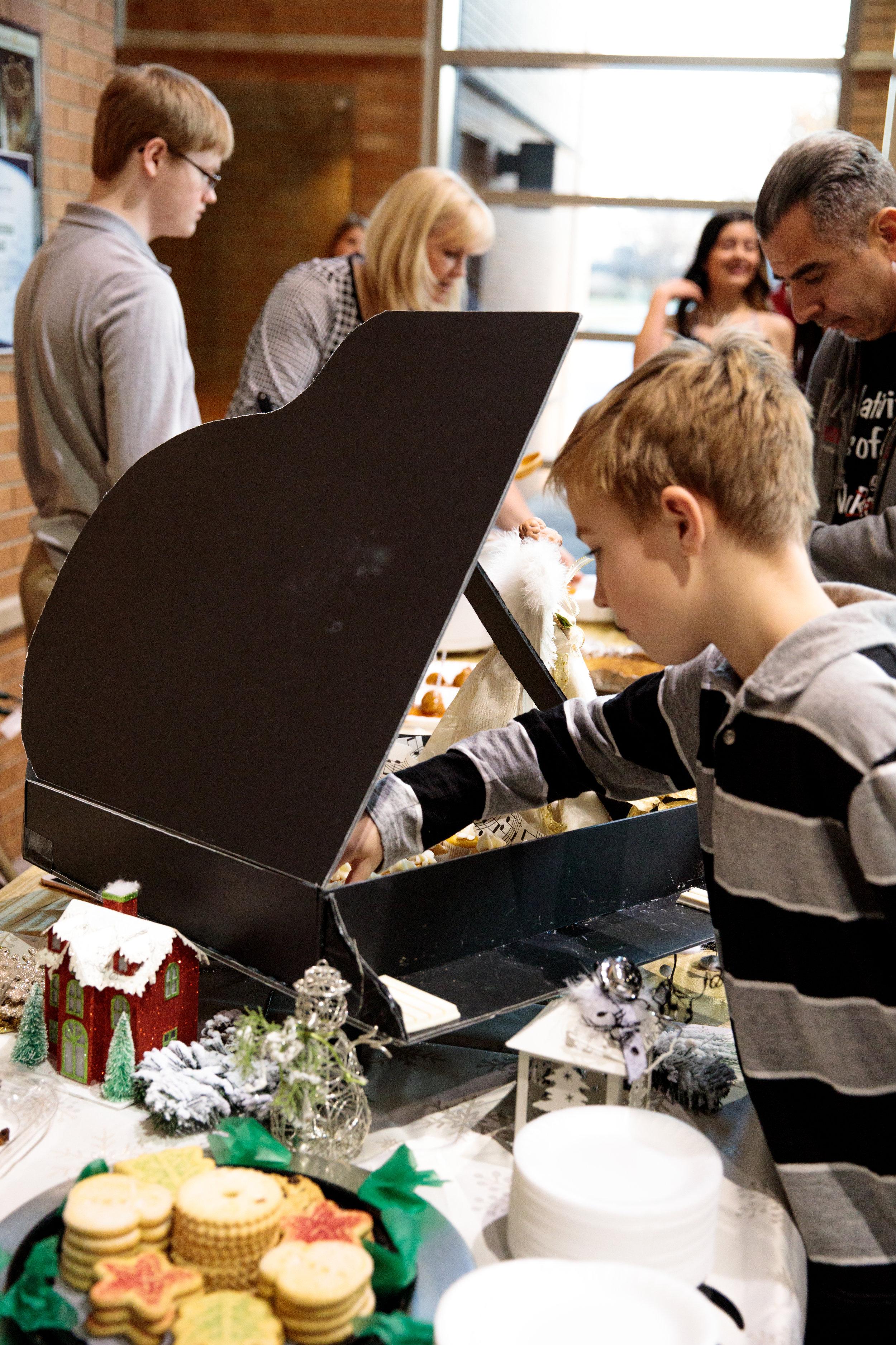 kid taking cupcake from piano-1.JPG
