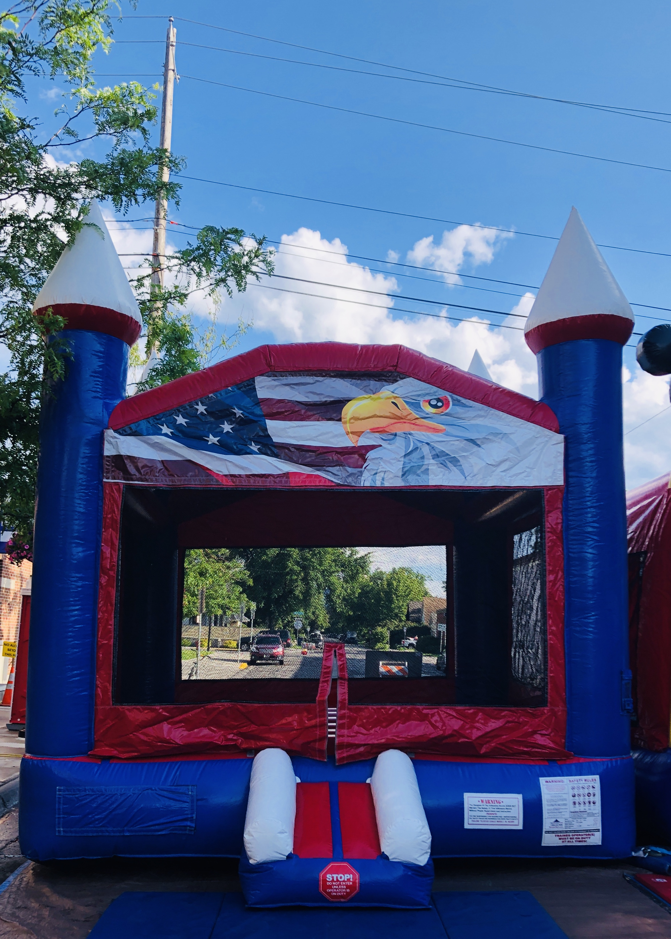 Red White & Blue Bouncer - Bouncer Size 17'L X 14'W X 15'HSpace required for setup 20'L X 20'W X 20'H3 hours $1496 hours $189
