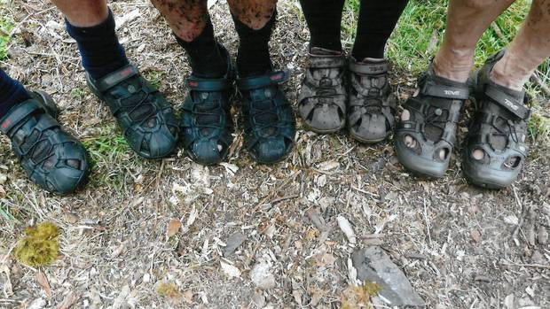The feet have it: Wanganui Tramping Club show off their sandals after wearing them over the infamous Dusky Track in Fiordland National Park.