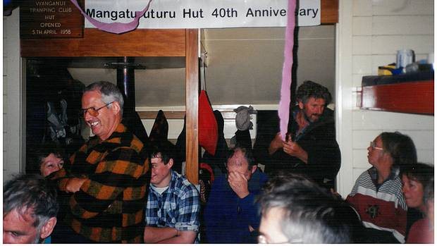 Wanganui Tramping Club members celebrating the Mangaturuturu Hut's 40th Birthday in 1998. Standing at left former president Darryl Greeks.