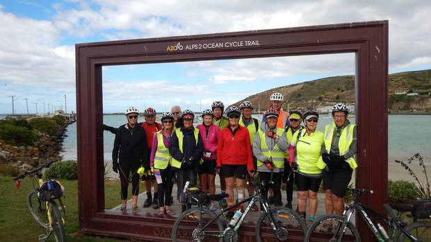 Members of the BOMBS group are happy after completing the Alps 2 Ocean Cycle Trail in Oamaru