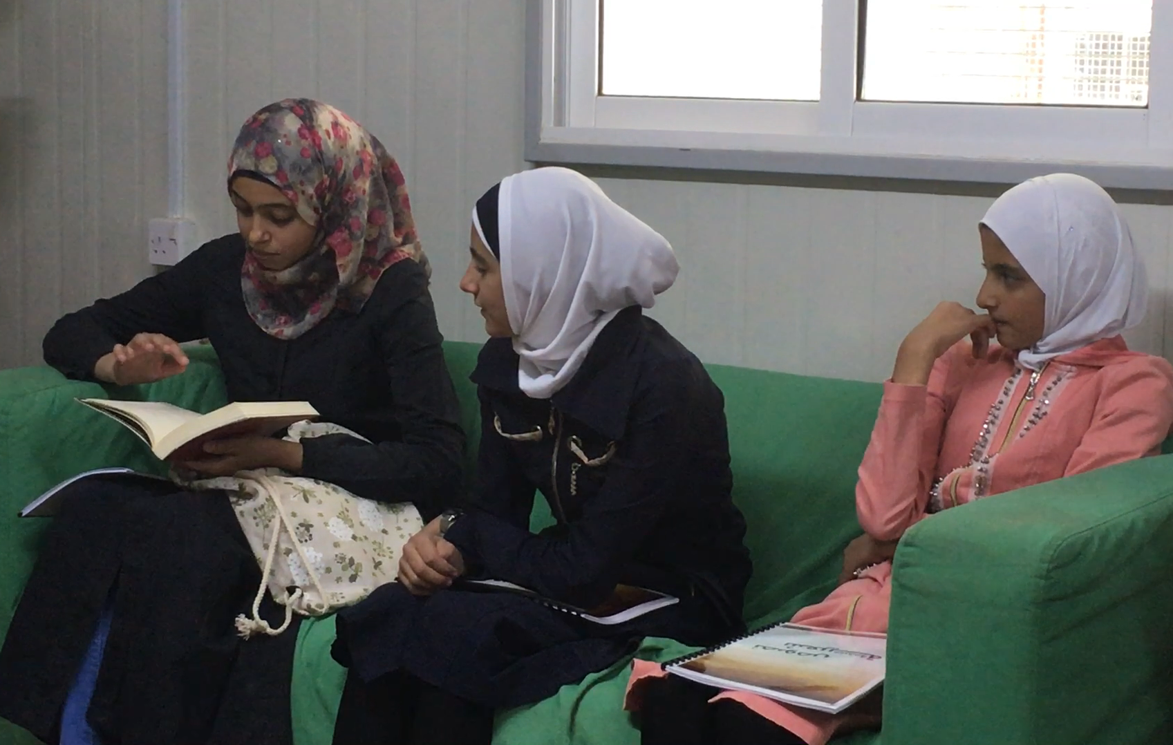 Students in Za'atari engage with classical Arabic texts and write their own poetry.