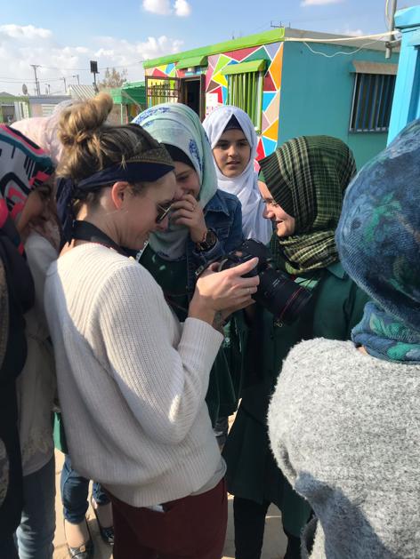 Volunteer Michelle Heimerman with the students of Za'atari.
