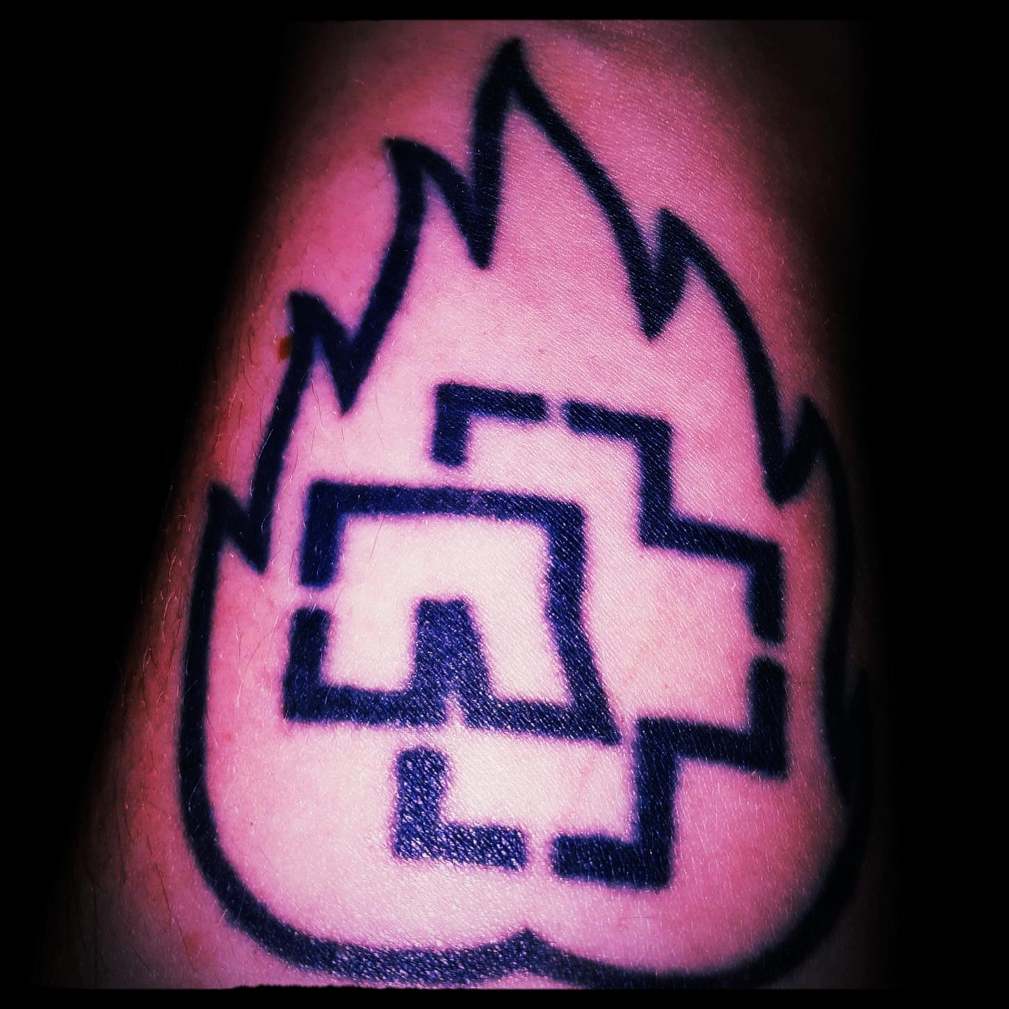 Sarah's little Rammstein tattoo.