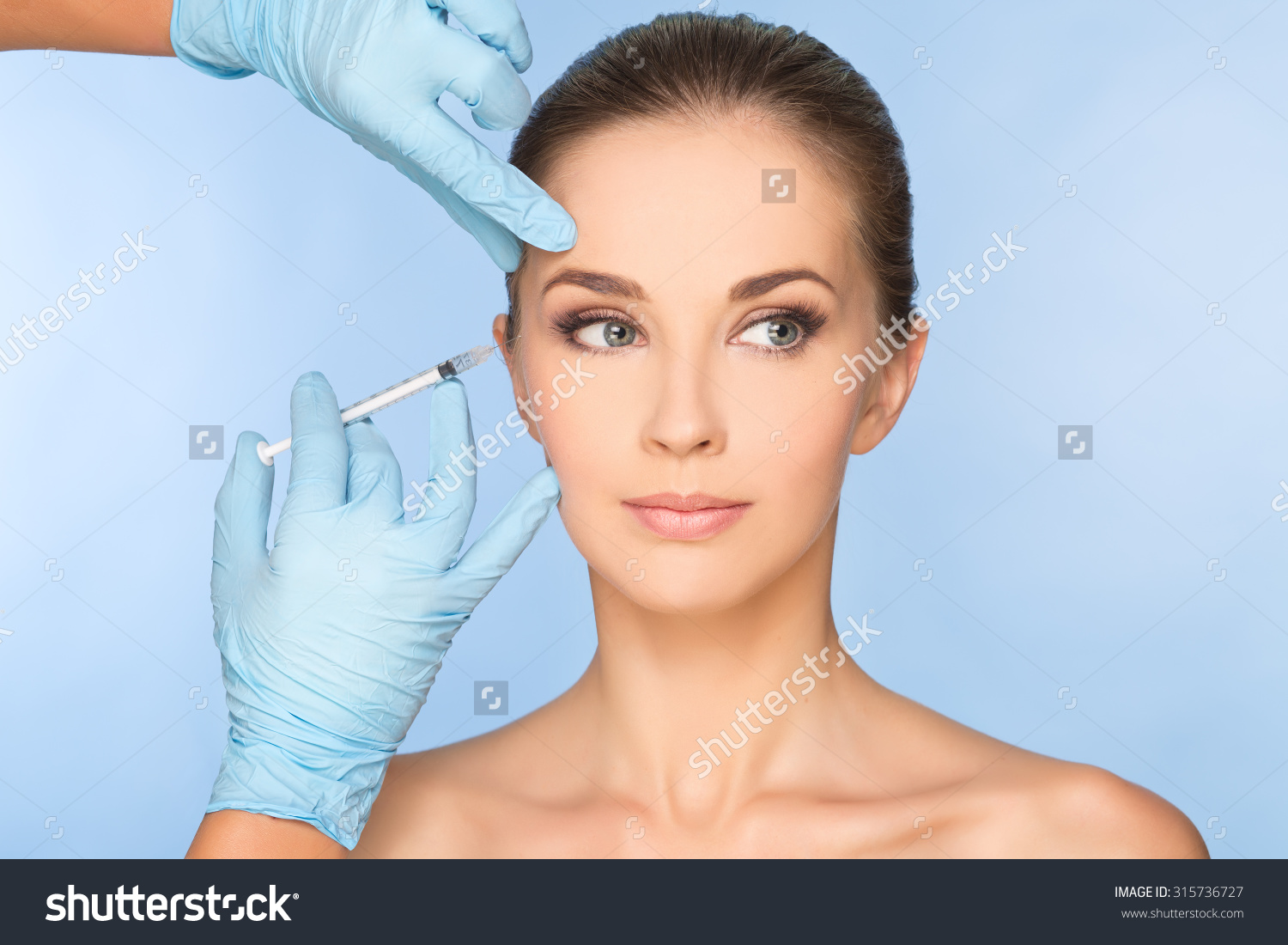 stock-photo-portrait-of-young-caucasian-woman-getting-cosmetic-injection-315736727.jpg