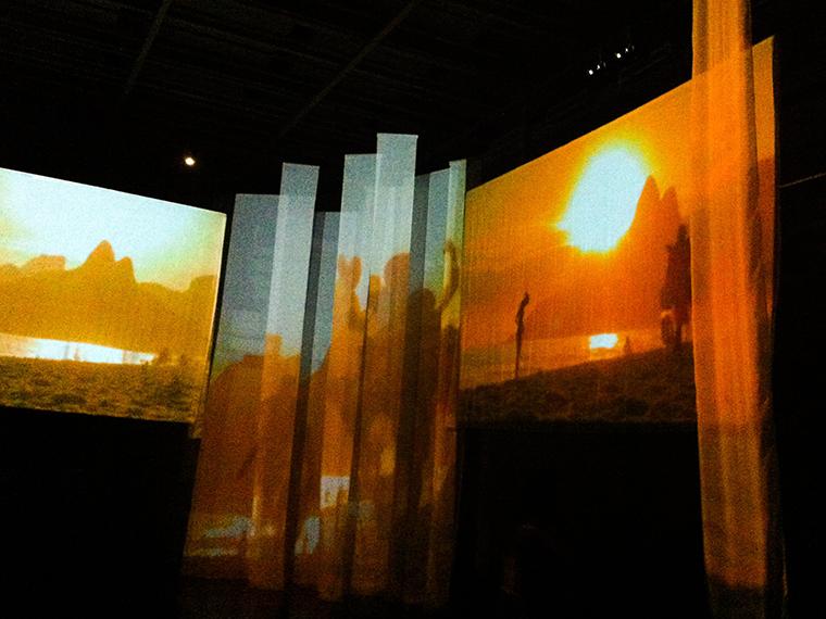 "Vinicius de Moraes ""Meu Tempo É Quando"" _Photograph of the video installation showing personal photographs of women and Brazilian landscapes"
