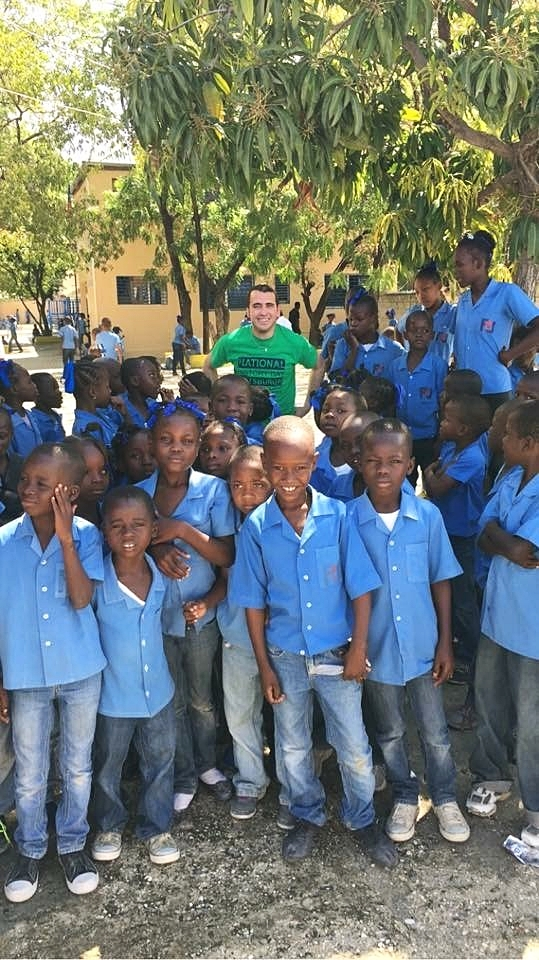 Our  Harvest for Haiti  coordinator Mitch meeting with school children in haiti.