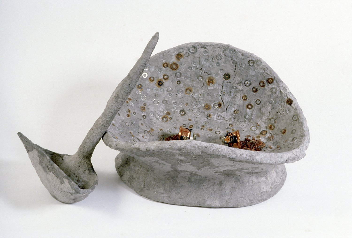 Container With Ladle    materials include;  armature with paper mache, hardware bits.  20 x 30 inches  1986