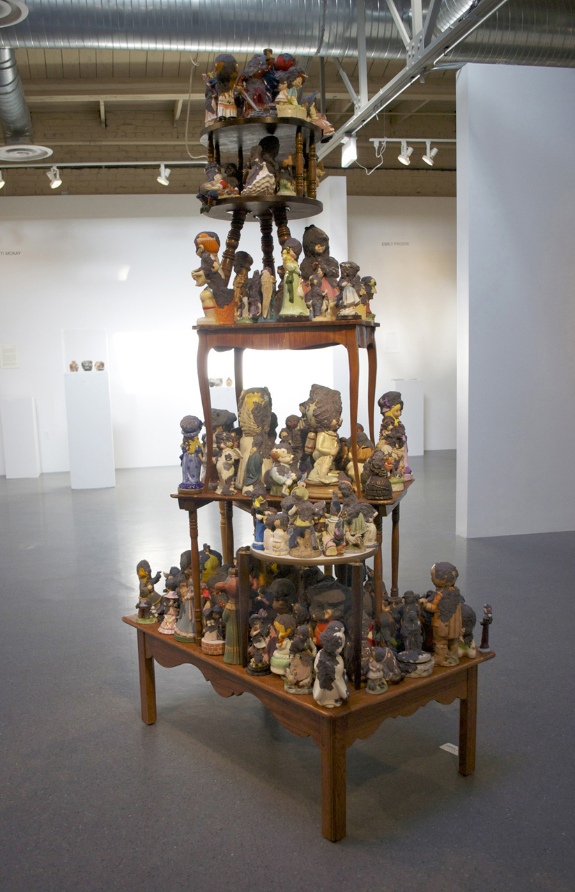 """Precious Moments  (Installation View)   2011  Tables, figurines, handmade paper 84"""" x 36"""" x 48"""""""