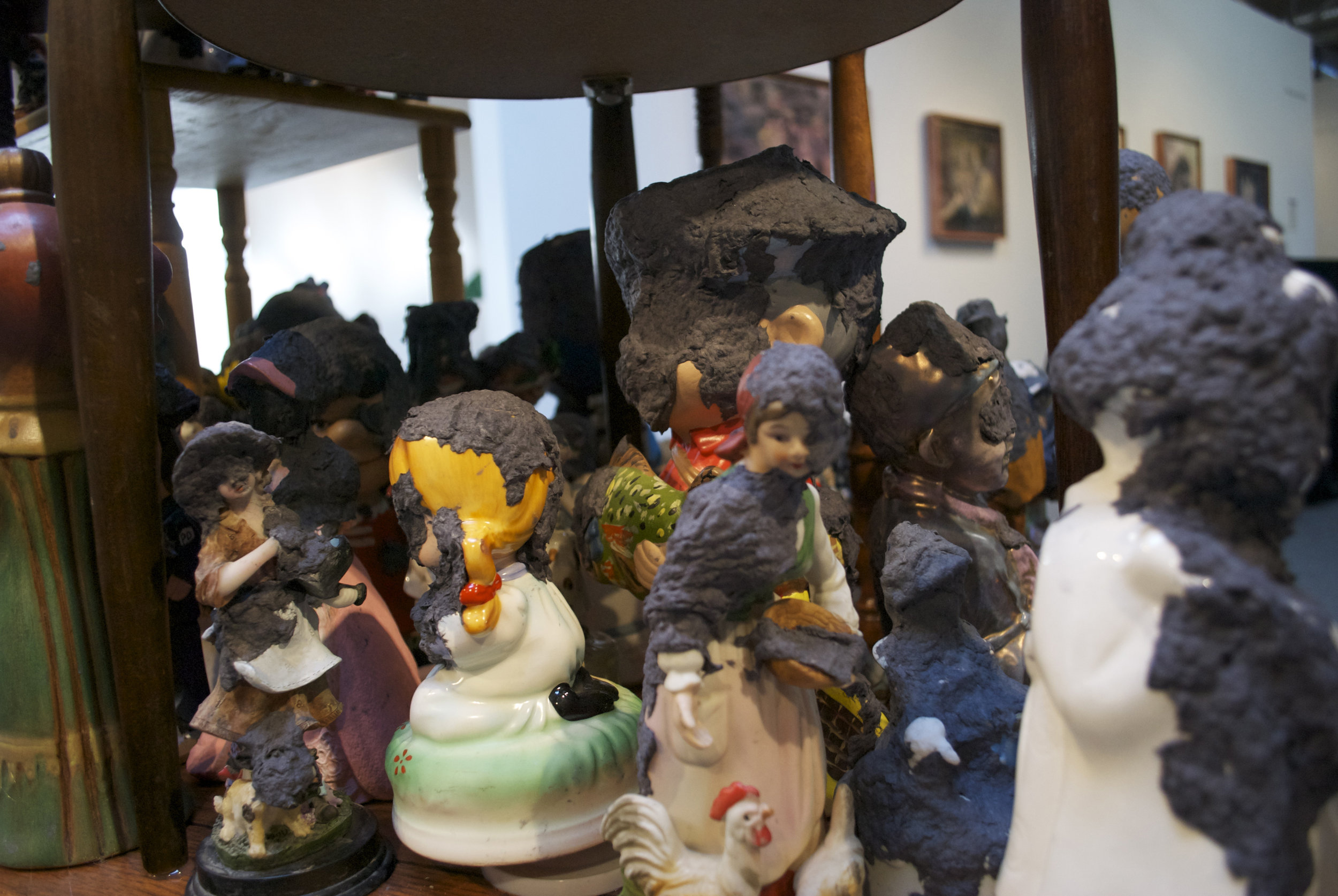 "Precious Moments  (Detail)   2011  Tables, figurines, handmade paper 84"" x 36"" x 48"""