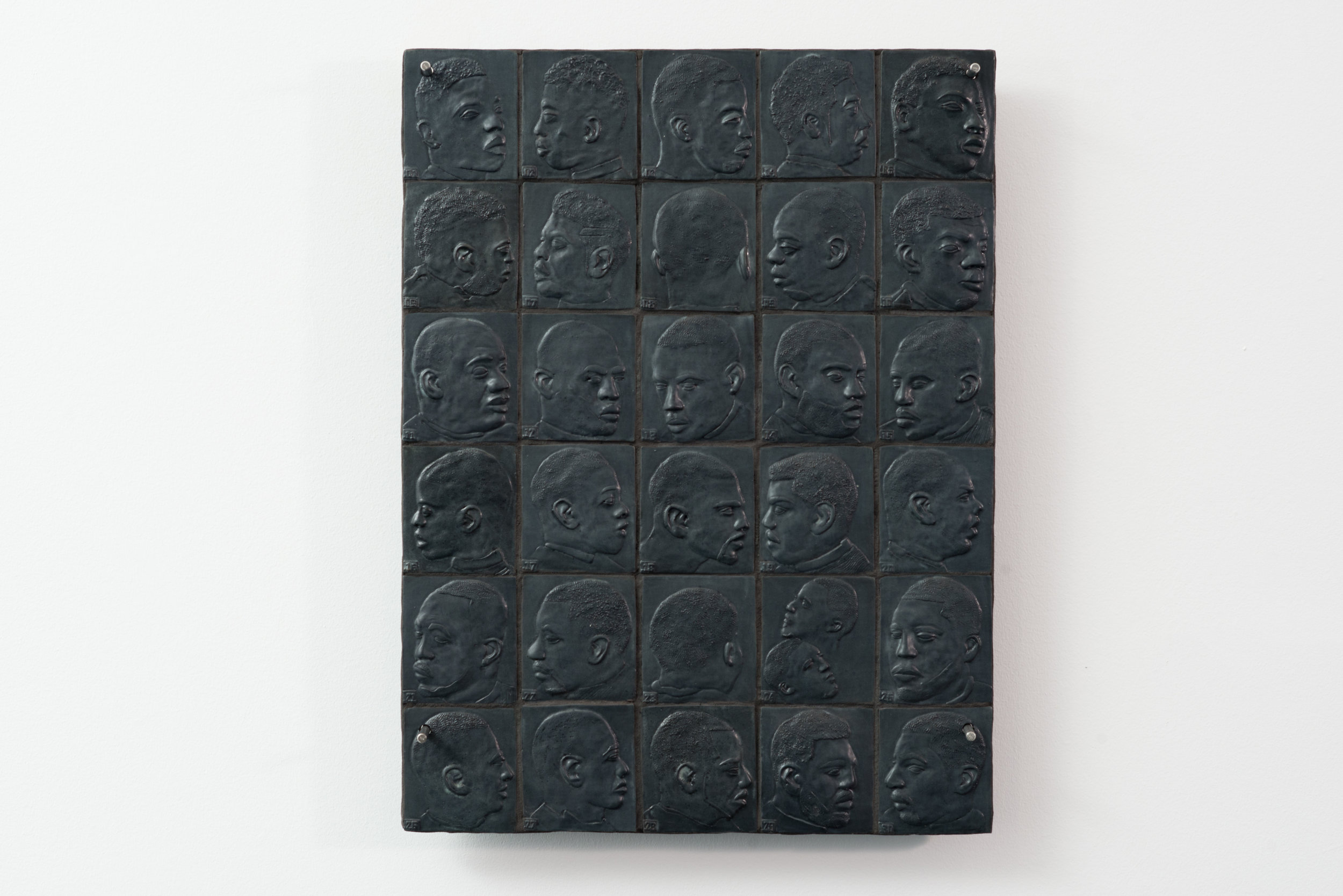 """Variations on a Fade  2018 Glazed Stoneware, Grout, Hardware 31"""" H x 24"""" W  Photograph courtesy of MCA Denver"""