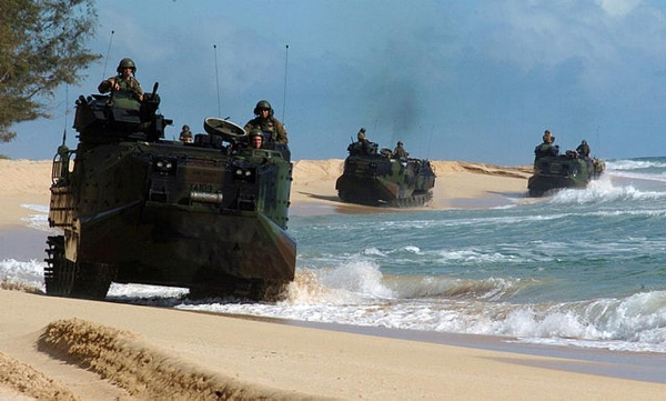 These aged amphibious assault vehicles are not hard for enemies to track and target. The Marine Corps must step up its investment in new technology if it is going to win wars against enemies equipped with the latest information technologies. (U.S. Navy photo by Journalist 2nd Class Zack Baddorf/RELEASED)