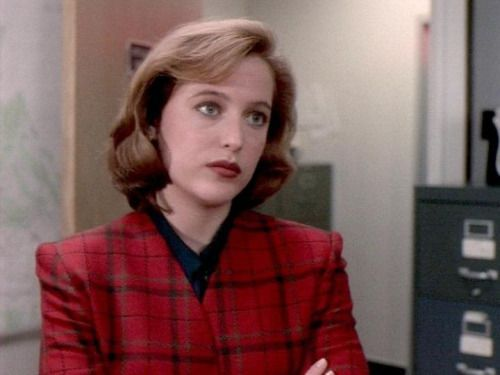 Dana Scully, in an early season of  The X-files,  wearing red plaid.