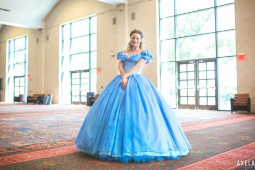 Teresa dressed in the pale-blue ball gown from the recent live-action  Cinderella  movie, posing in a convention hallway.