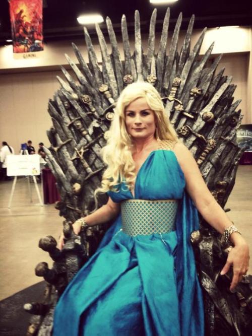 Teresa as Daenerys Targaryen, sitting on the Iron Throne. Her wig is notably iffy.