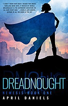 The cover of  Dreadnought , by April Daniels, showing a person with a flowing cape facing away from the viewer, looking at a cityscape.