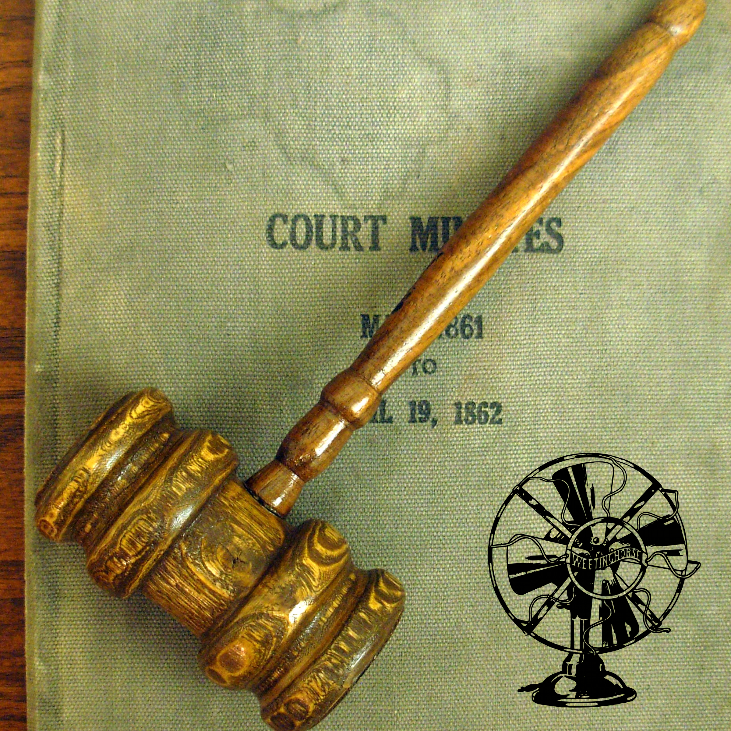 Episode 4's cover: a gavel rests across a law book.