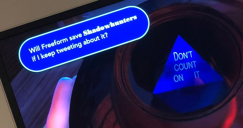 """A screenshot of a television: a pop up asks """"Will Freeform save Shadowhunters if I keep tweeting about it?"""" The magic 8-ball on the screen reads """"Don't count on it."""""""