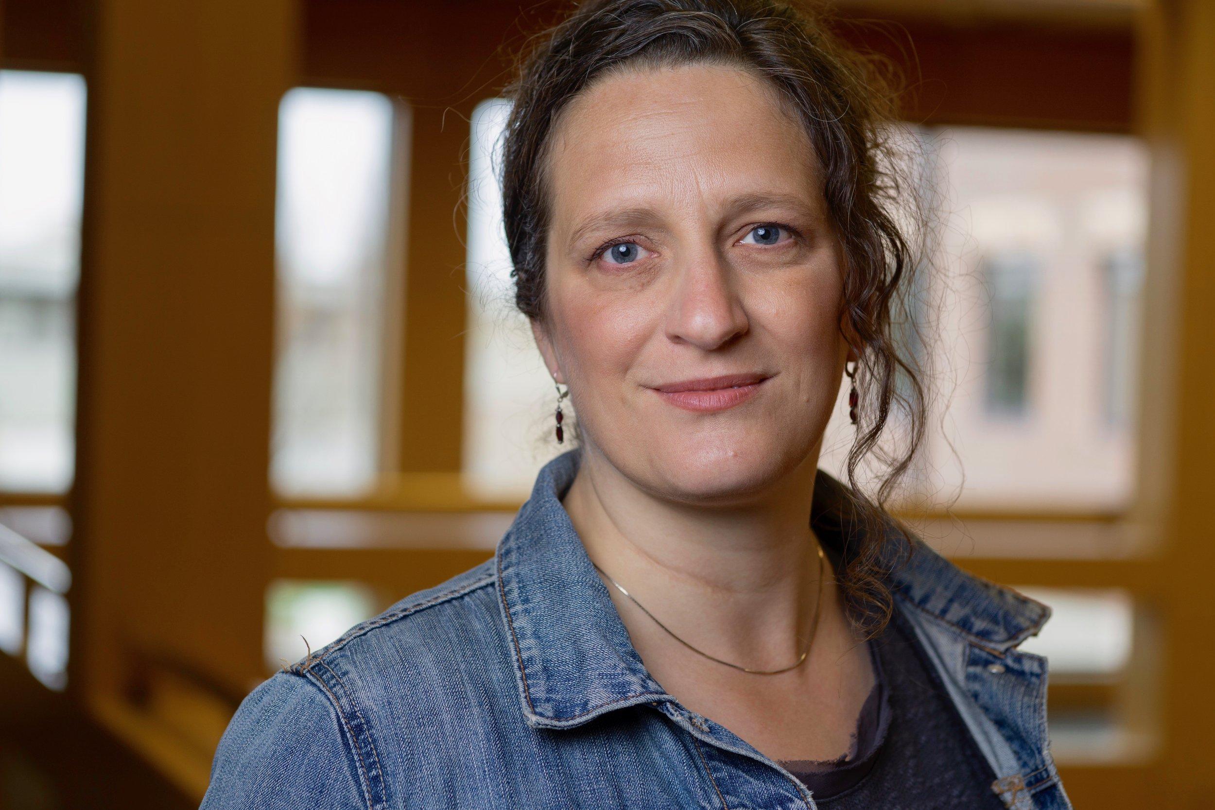 A headshot of Anne Jamison. She wears a jean jacket.