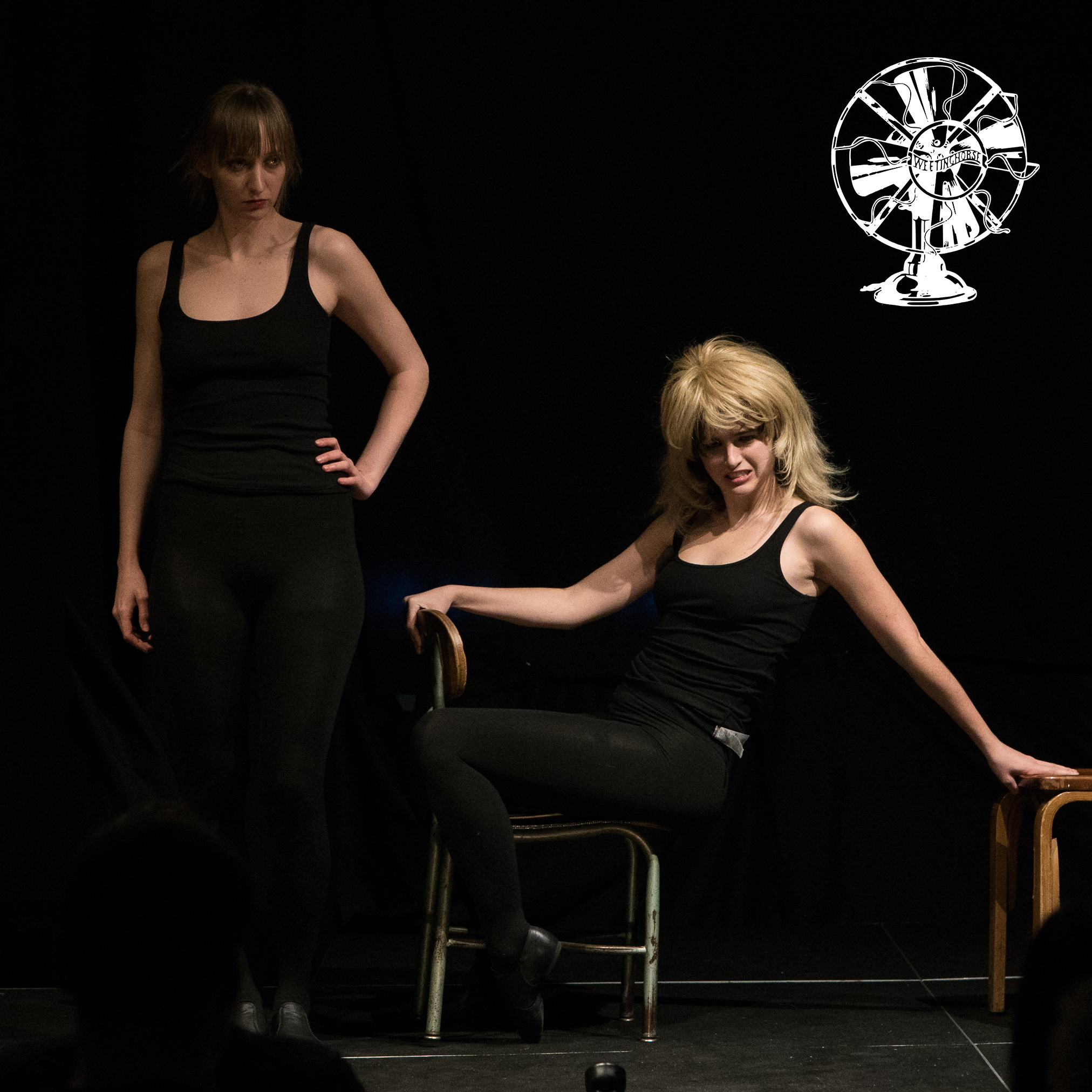 """Episode 103's cover: Emily Allan and Leah Hennessey on stage performing """"Slash."""""""