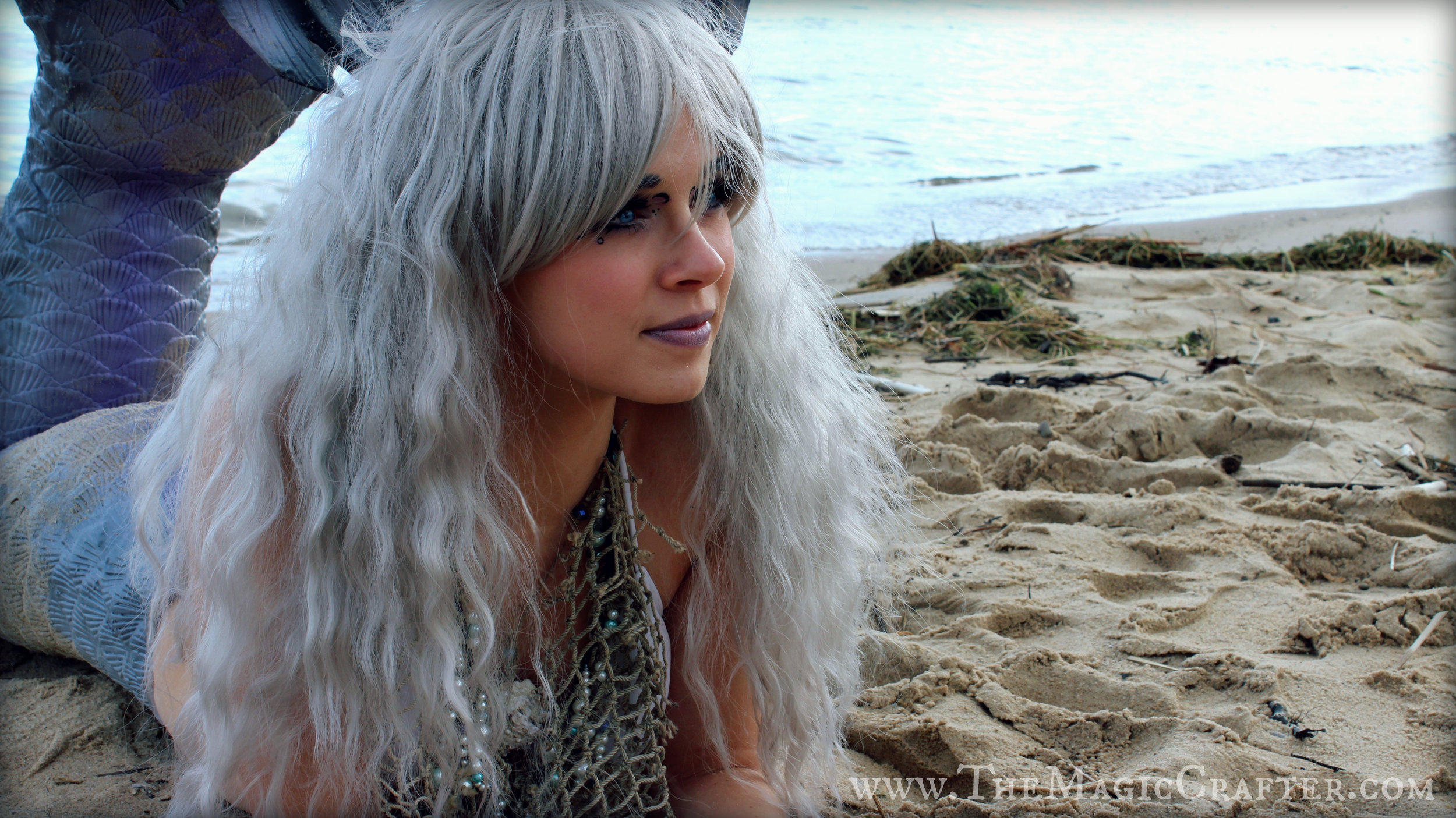 "My poor hair got a little messed up after I accidentally fin-slapped myself in the face a few times! But luckily, this silver ""Rhapsody"" wig by  Gothic Lolita Wigs  is super durable and looks fabulous no matter what I put it through! (It's even gone swimming...!)"