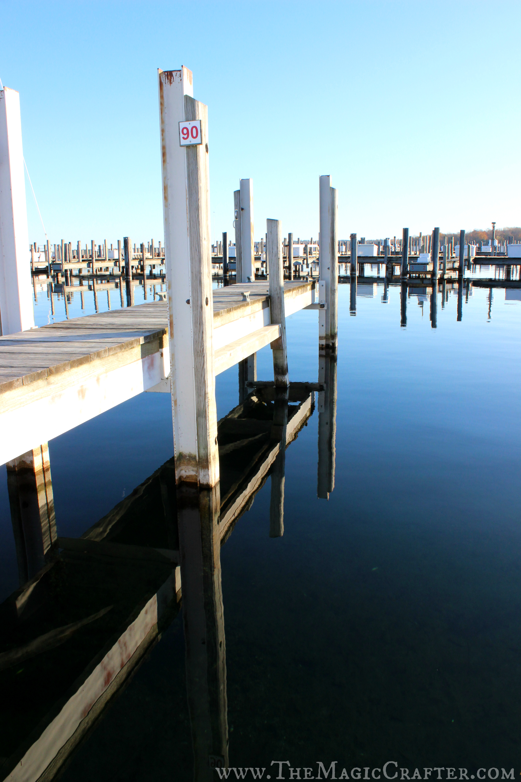 The water on the left side of the marina was much calmer than in the other areas of the marina. This reflection is almost a perfect duplicate of the dock it imitates.