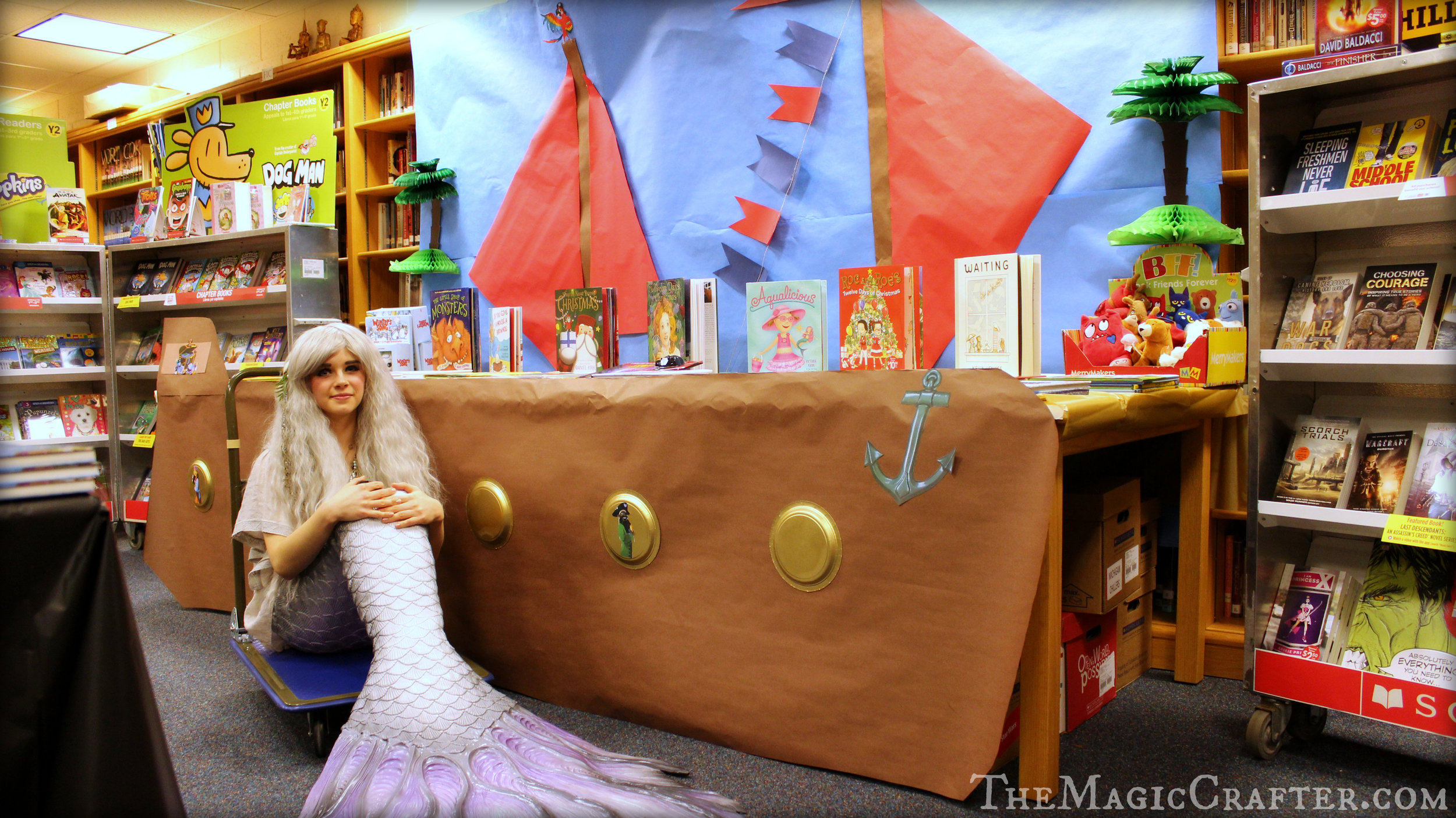 Yesterday (November 29th of 2016) I was a mermaid at the book fair of Northport Public School from 6:00 PM- 8:00 PM. The theme of the event was pirates, so I felt right at home around the ship that was anchored in the library of the school. It looked really neat and made for a lovely perch for some of the books to sit on. However, the pirates were nowhere to be seen...