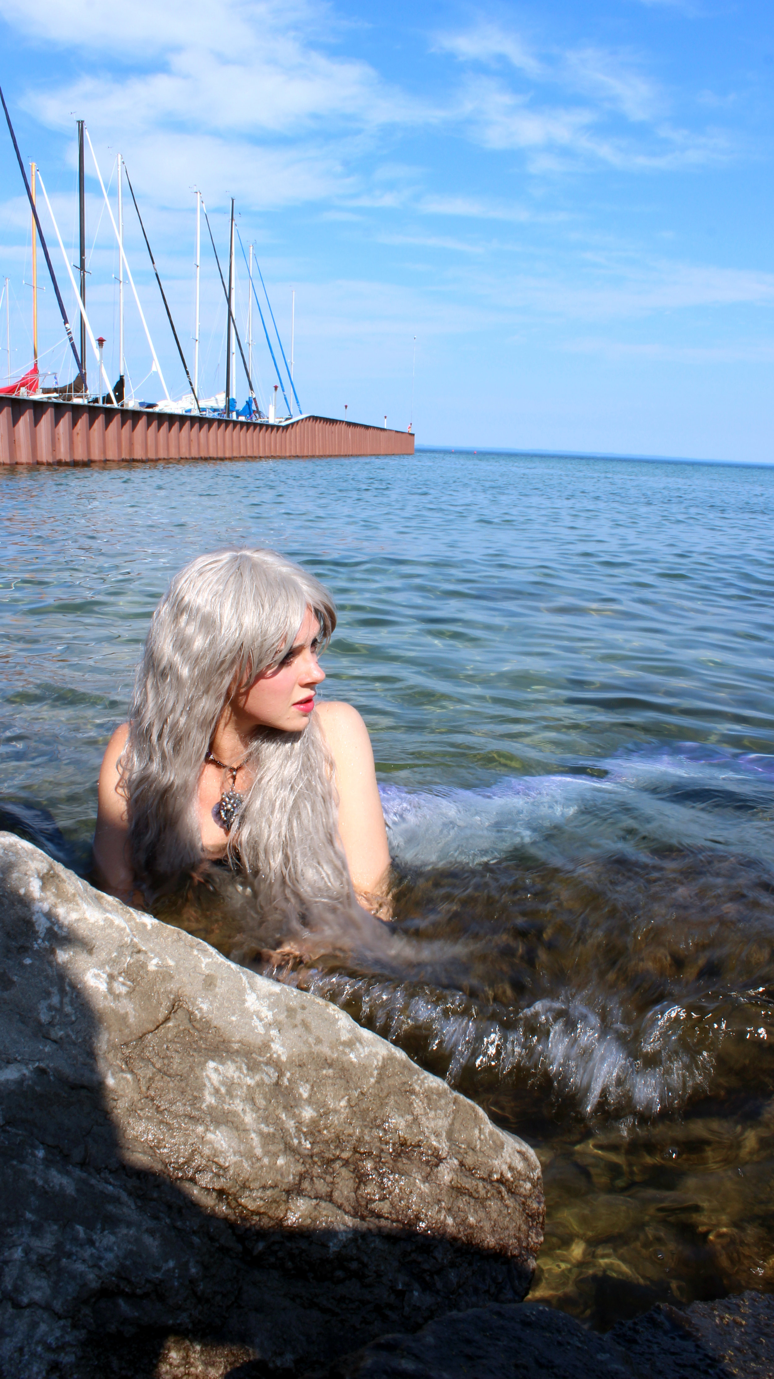 Mermaid Phanton, one of Lake Michigan's mermaids oftentimes comes up to the rocky shoreline near the docks at Northport's Marina. Here she can be seen gazing out into the distance.