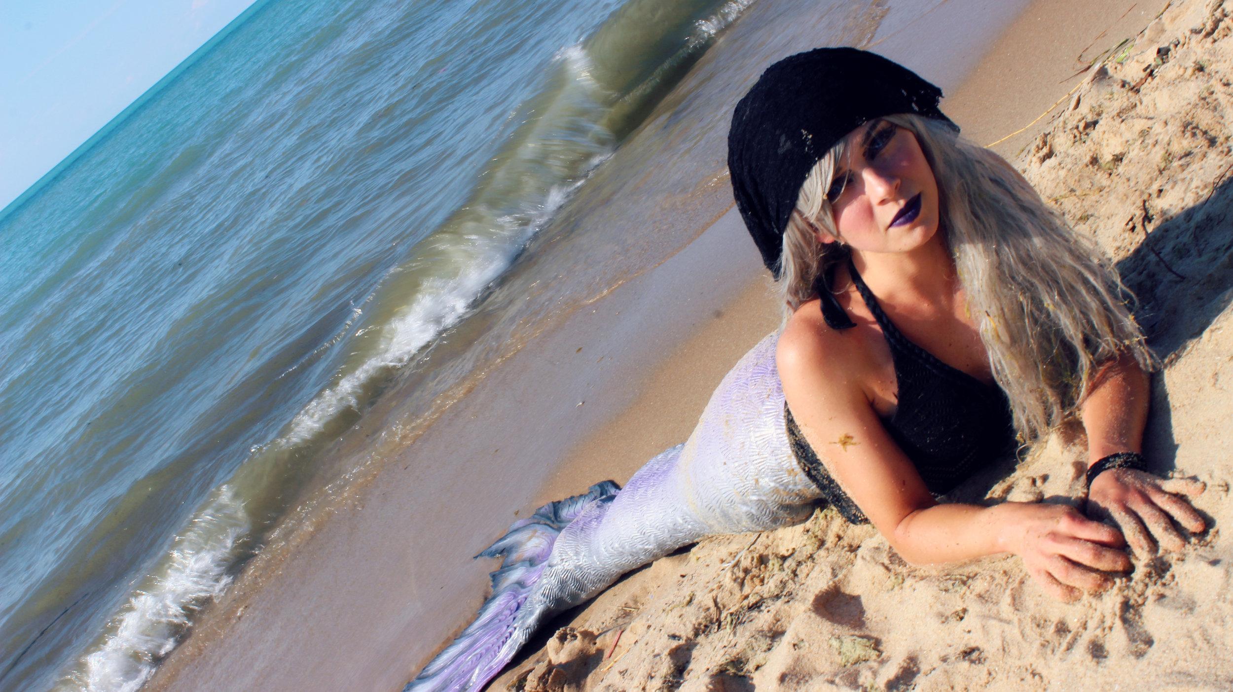 silicone-mermaid-tail-mermaid-pirate-on-the-beach-sideways-purple.jpg