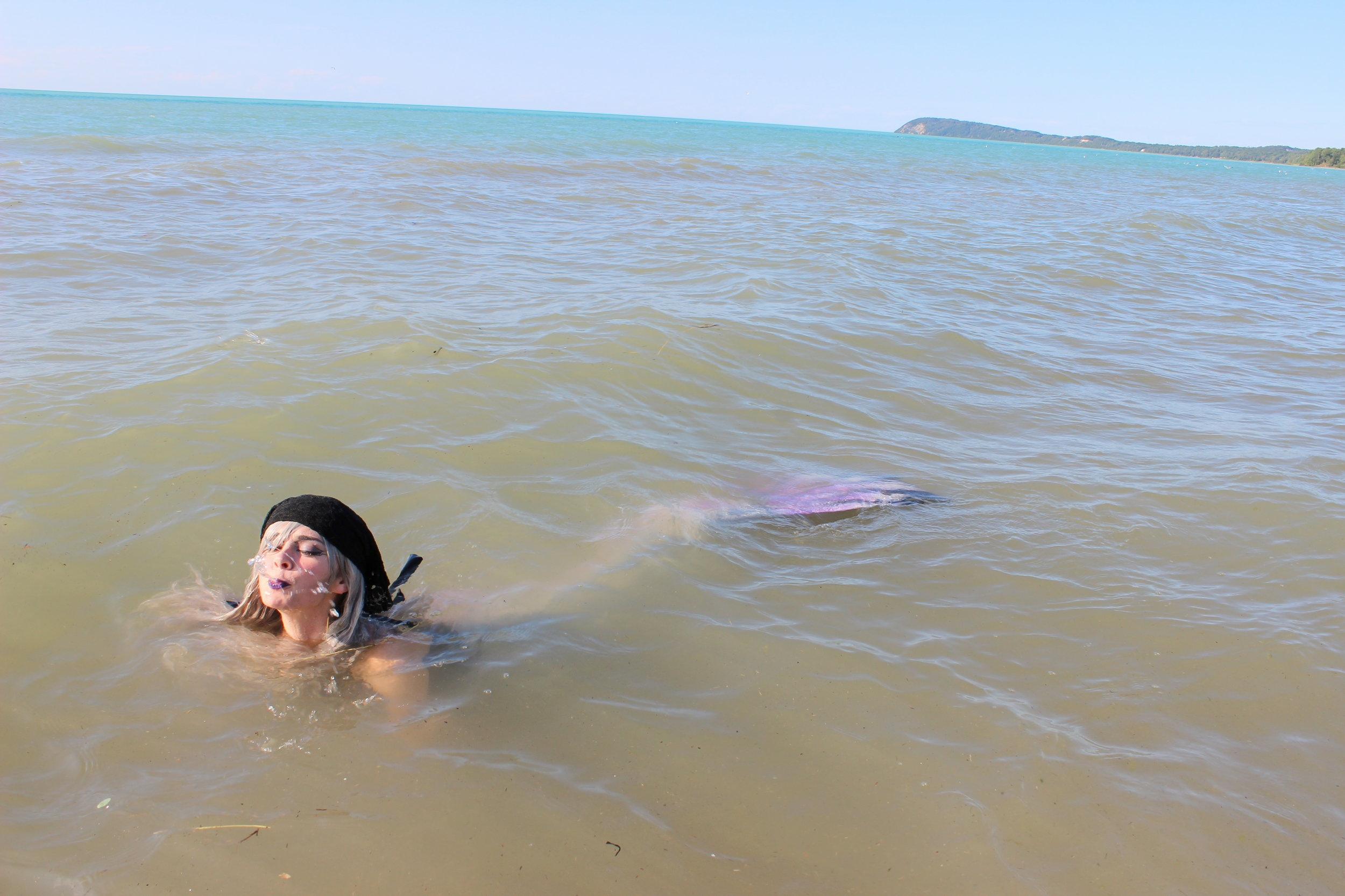 Mermaids spitting water out of their mouth: Mermaid Phantom spitting nasty lake-water out of her mouth. Yuck!
