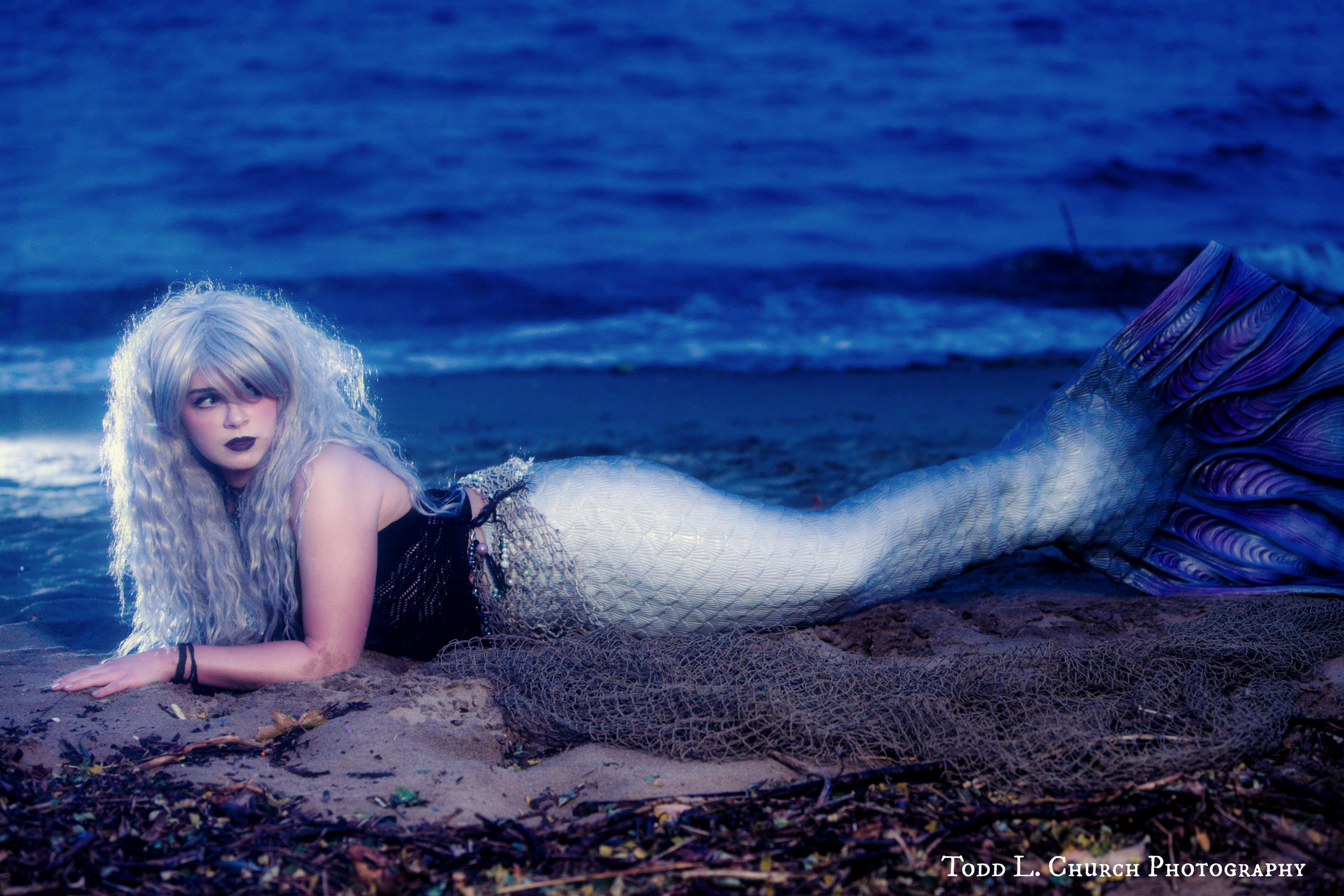 Professional Mermaid Photos taken at Night: Pictures of Mermaid Phantom were taken in October of 2017 by Professional Michigan Photographer, Todd L. Church. Phantom is one of Traverse City's only real mermaids. She's not spotted much in the colder seasons, so these are very rare pictures! ;)  Photo by: Todd L. Church Photography, Model: Mermaid Phantom of www.themagiccrafter.com