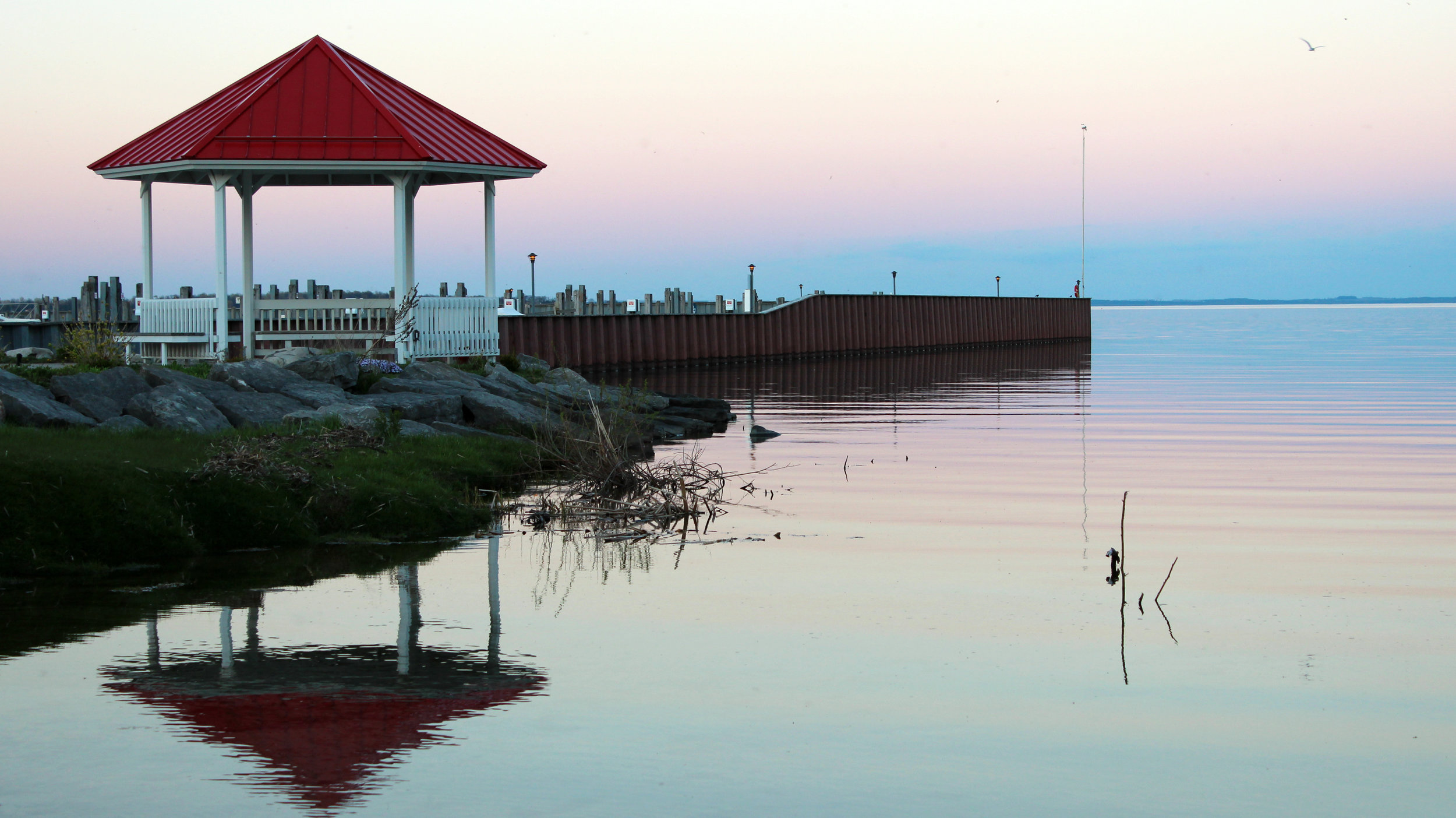 Northport, Michigan: Northport's red and white gazebo casts its reflection on the glassy still waters of Grand Traverse Bay. This is one of the most beautiful locations in all Leelanau County. Sometimes, mermaids can be spotted swimming here.