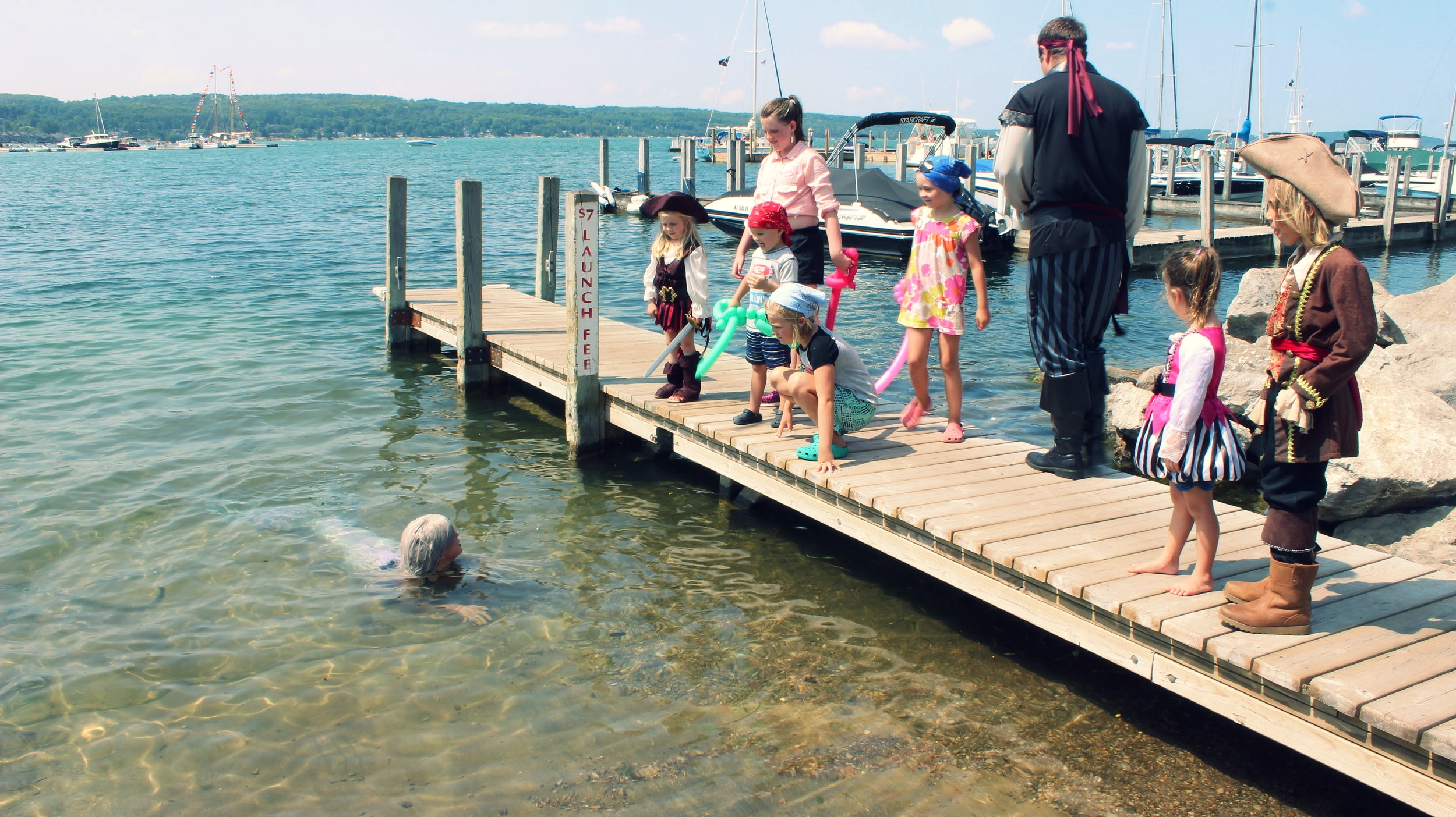 There was a real live mermaid swimming in Lake Michigan during the Boyne City Pirate Festival! Pirates of all ages seemed to be fascinated by Mermaid Phantom's tail!