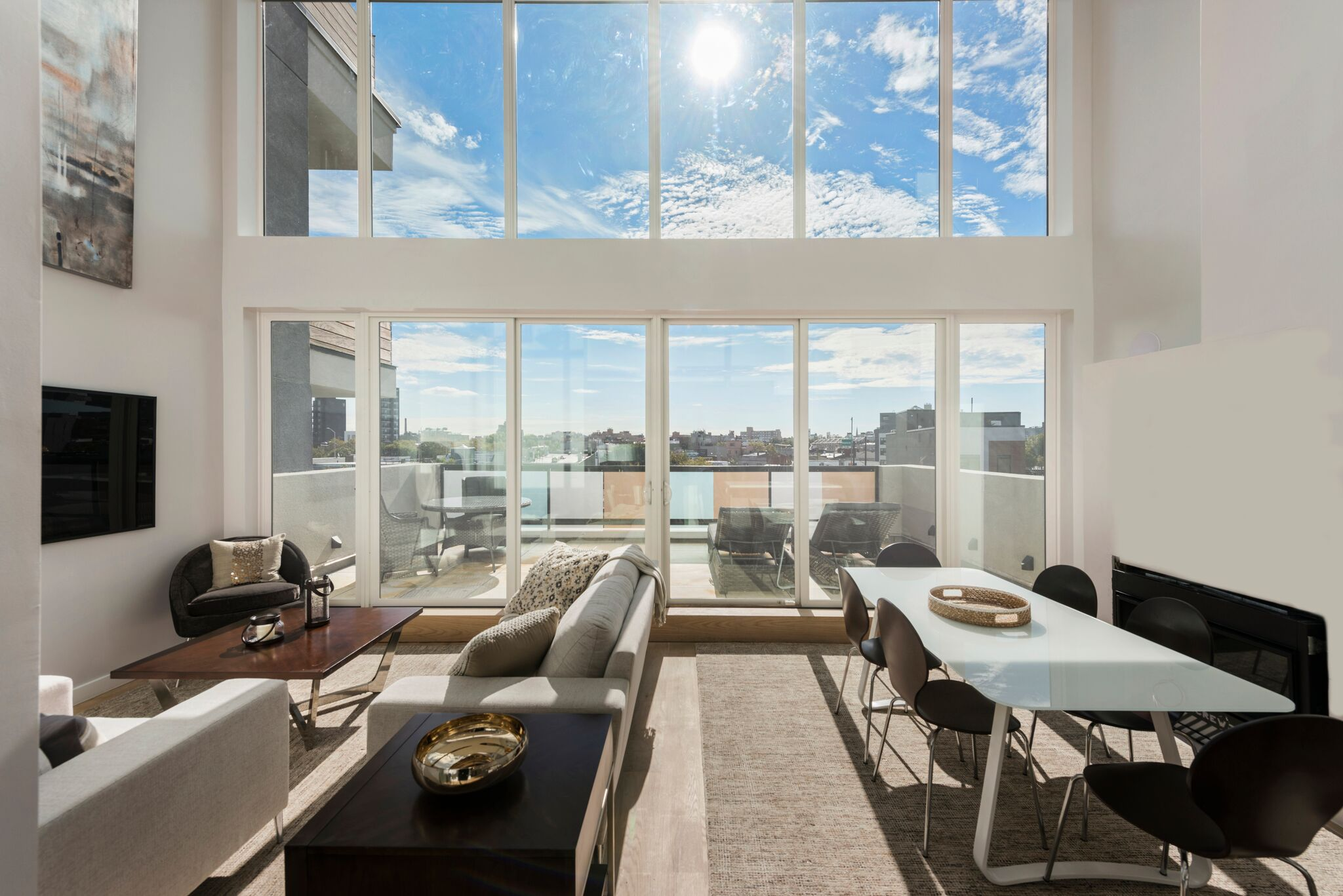 Floor-to-ceiling Windows in Wide Open Living Room