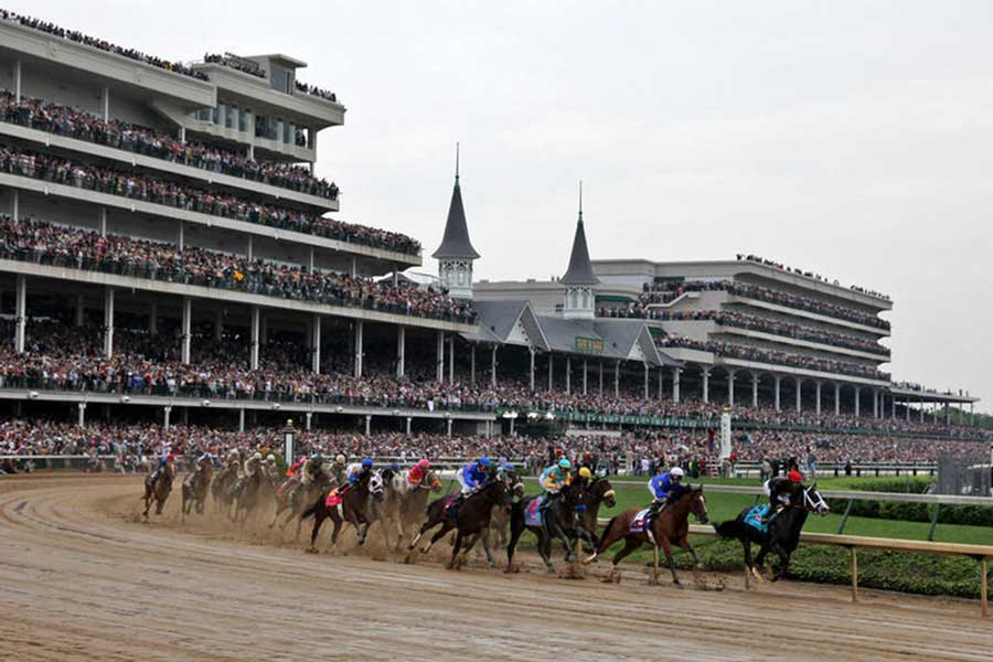 a view from the first turn clubhouse of The kentucky derby at churchill downs in louisville, kentucky