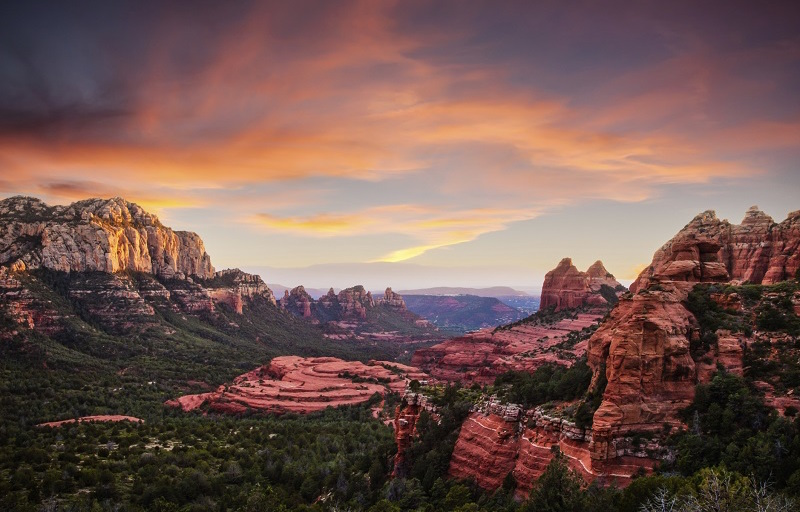 If you want to see the red rocks of Sedona from the car, there are many beautiful drives. Airport Mesa is in the center of Sedona and offers spectacular views of the entire region. Catching a sunset from the mesa is worth dealing with the crowd.  Oak Creek Canyon (Route 89A) between Sedona and Flagstaff is another spectacular drive. The canyon road is steep and windy (not recommended for RV's), but beautiful.