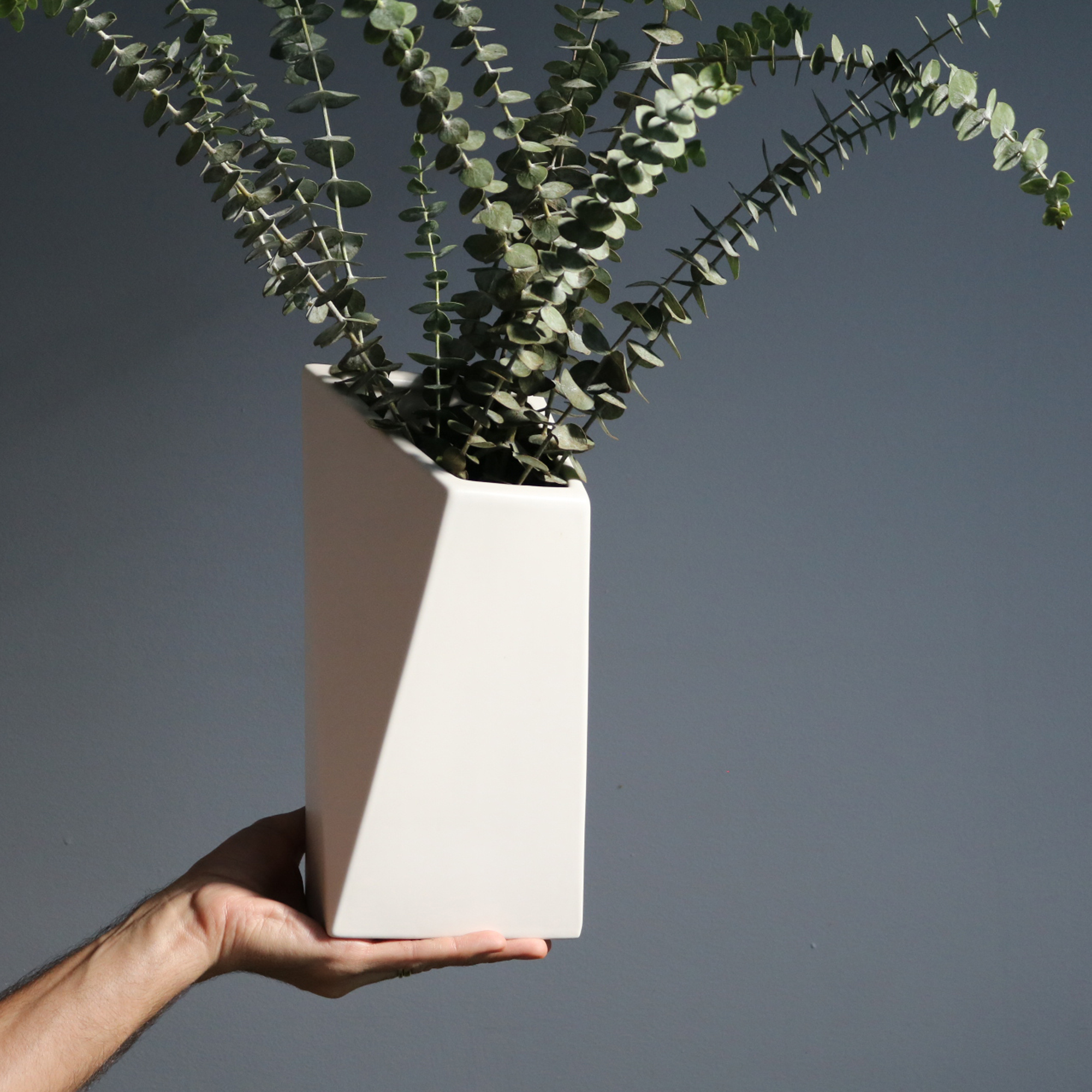 FOR THE PERFECT ASSISTANT :TRAPEZA PAUL VASE - Everyday they make your perfect arrangements - repay the favor with this gorgeous vase and a bouquet of something glamorous. Minimalist and geometric, the Trapeza Paul Vase is stylish, sophisticated, and versatile enough for any decor. A real lift for any room.Handcrafted by Cecile Mestelanin Lisbon's Campo de Ourique district.SHOP NOW >