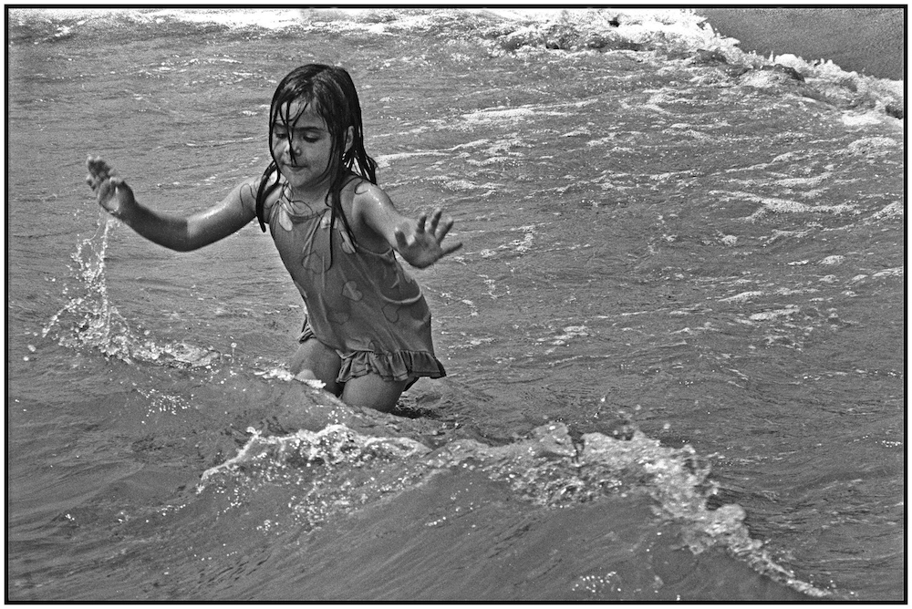 Girl enjoys Atlantic Ocean. Brighton Beach. June 15, 1986