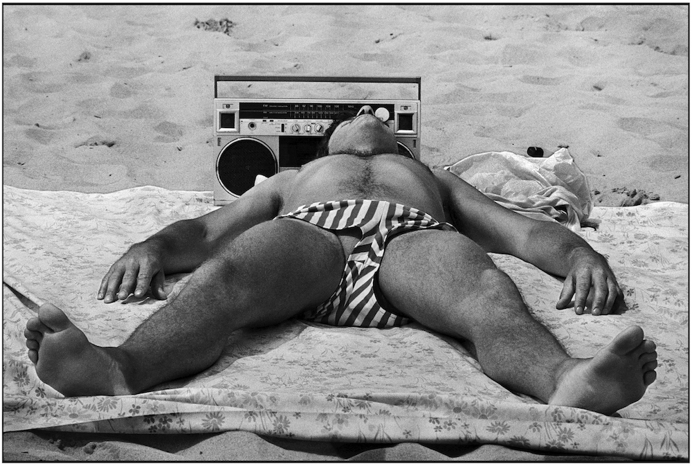 Man with portable radio. Brighton Beach. June 15, 1986
