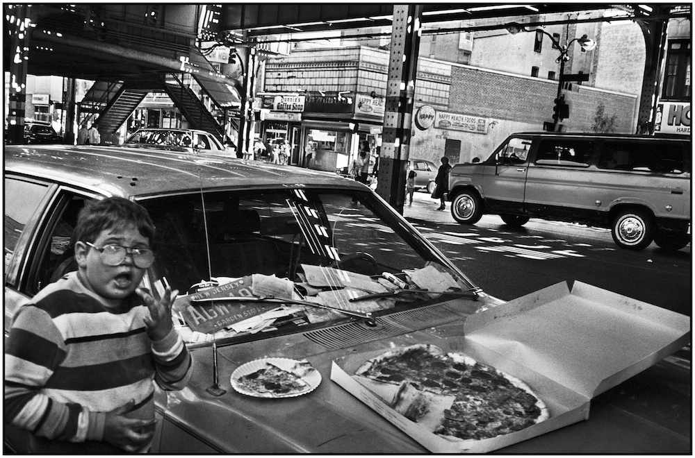 Boy, pepperoni pizza, and a New Jersey car, Brighton Beach Avenue. August 30, 1986