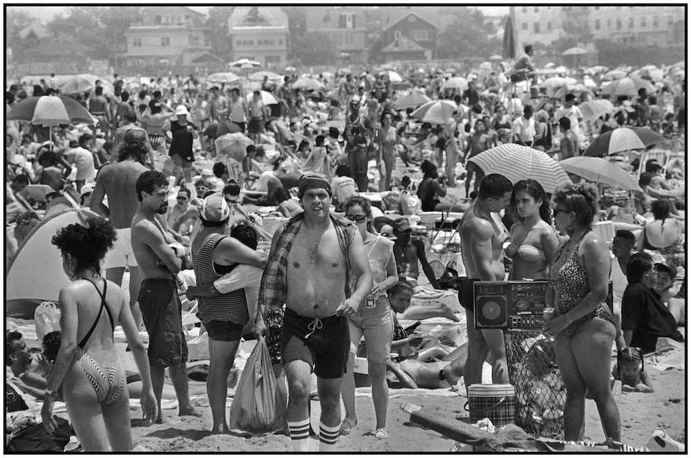 Man sells beer on a July 4th, holiday afternoon. Brighton Beach. July 4, 1990