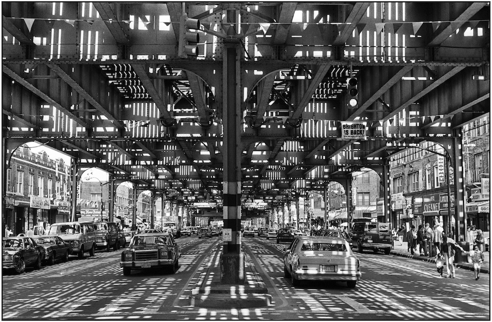 Brighton Beach Avenue, the main shopping/commercial street in Brighton Beach. Overhead is the steel structure and MTA train tracks, more commonly known as the elevated subway. May 9, 1990