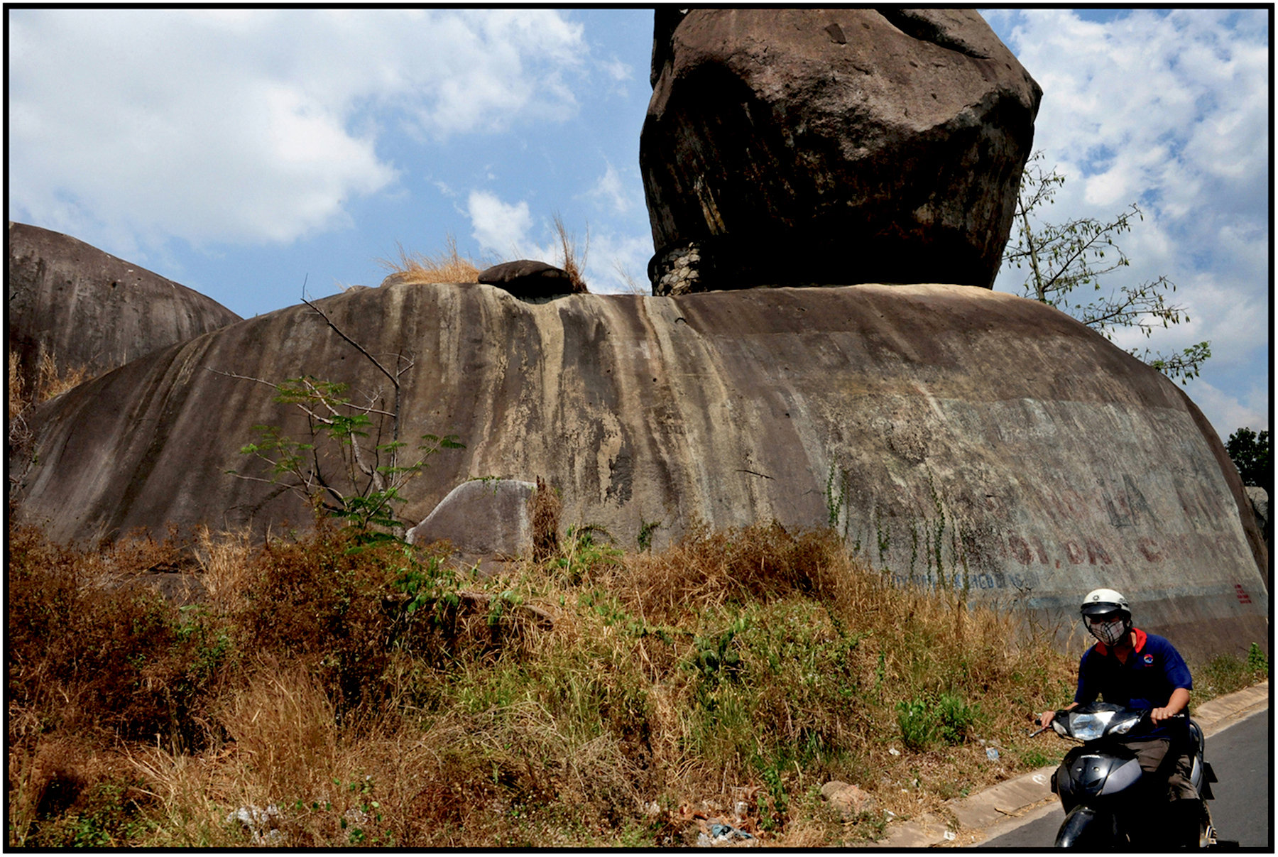 Rock formations on highway north of Saigon/HCMC, Mar. 2015. #1072
