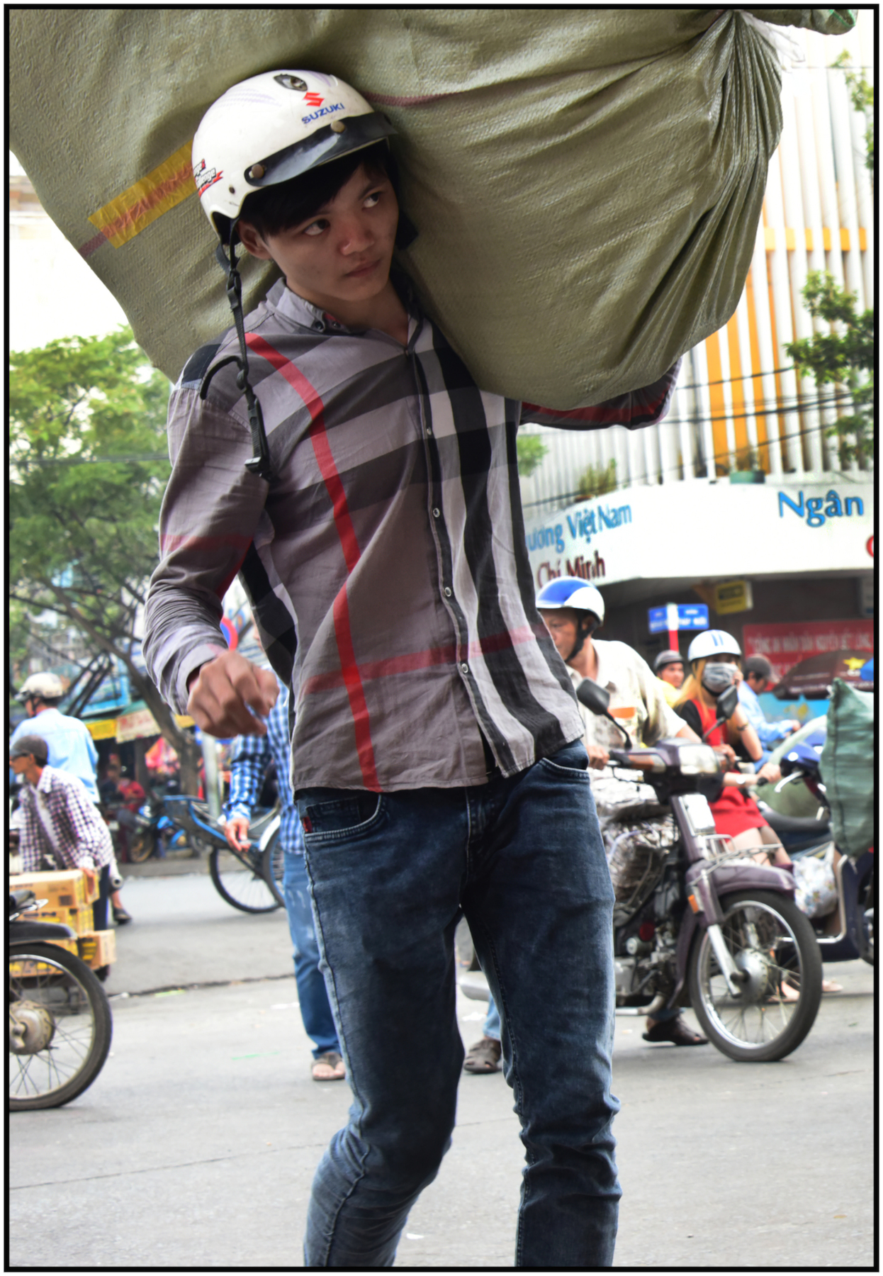 Worker carries merchandise from truck to Binh Tay Market, Cholon, Saigon/HCMC, Dec. 2015. #4147