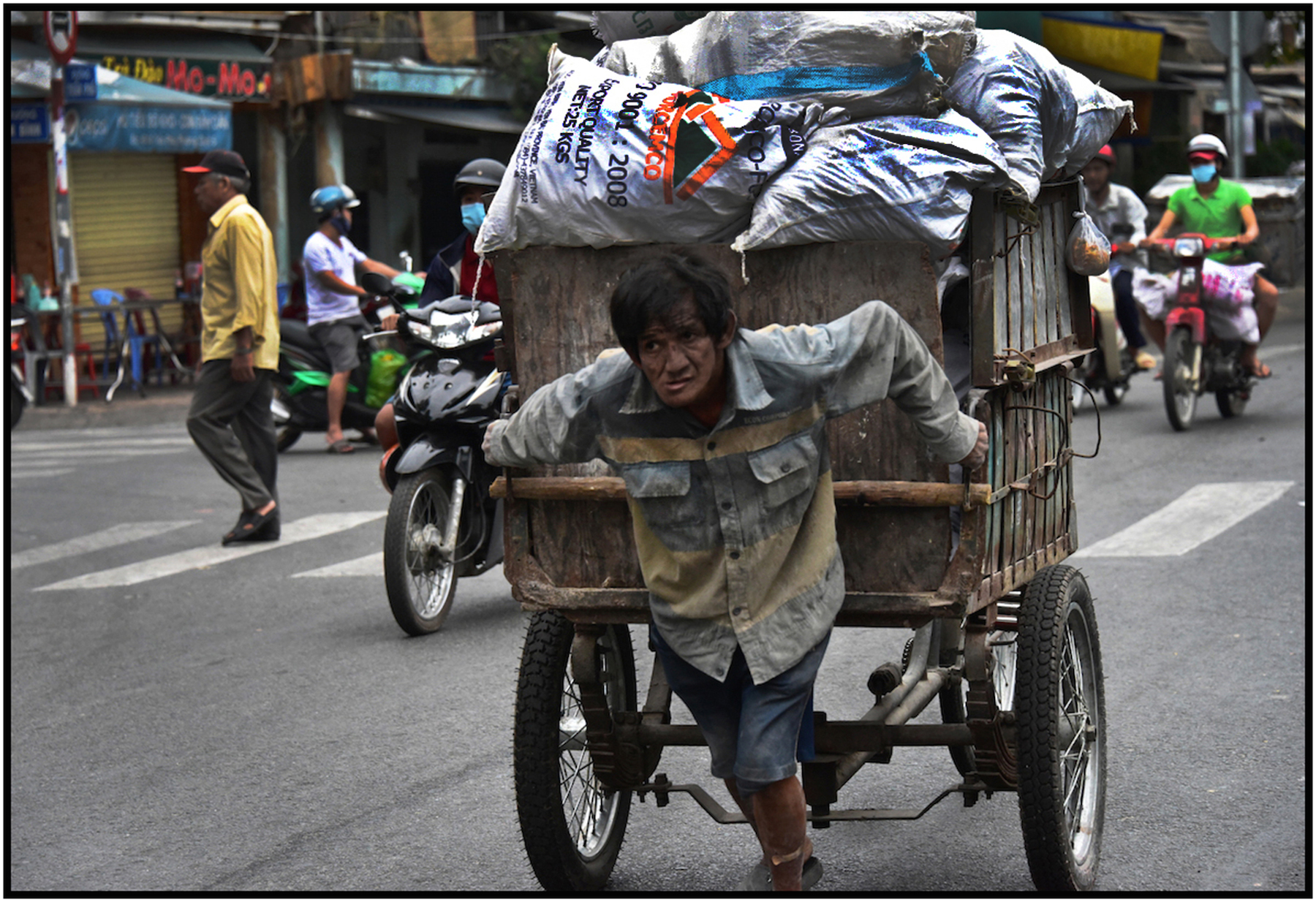 Impoverished worker and recyclables, Saigon/HCMC.Dec. 2015. #4294