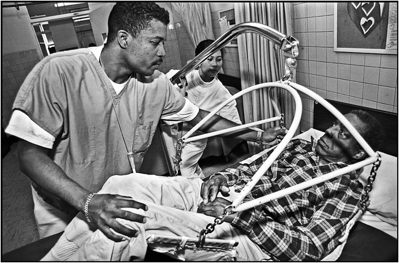 Nurse's Aides help long-term care patient at Goldwater Memorial Hospital, Roosevelt Island. 19--.