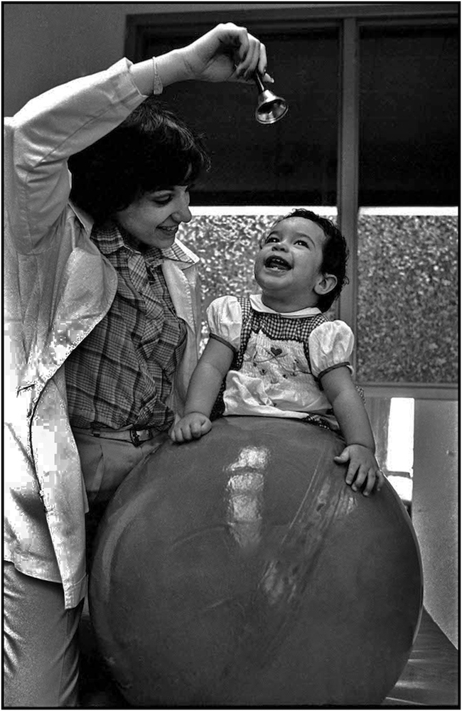 Occupational Therapist Anabel Gomez works with Ana Bodillo at Kings County Hospital. 1981.
